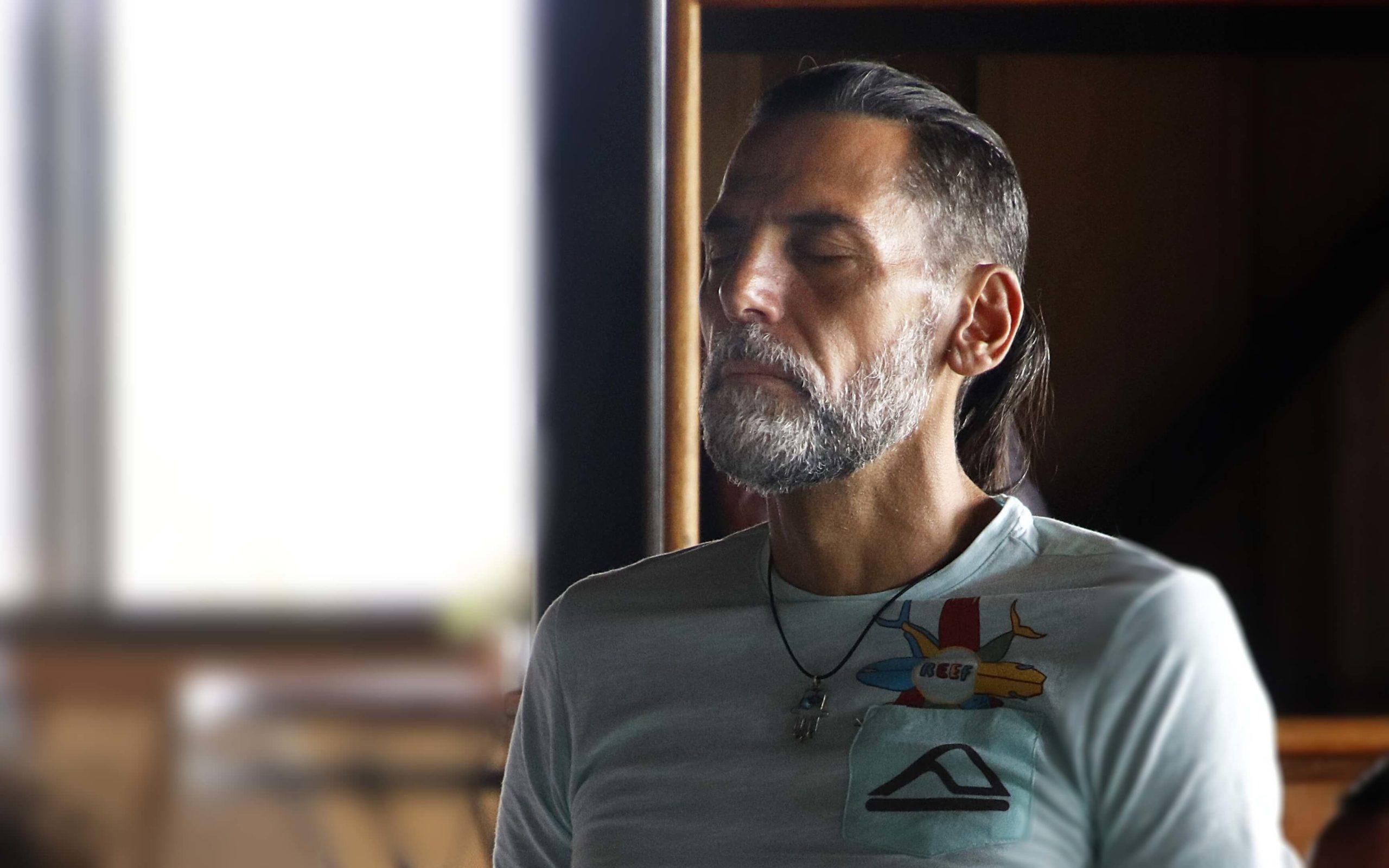 Man Meditating Becoming a member page top banner